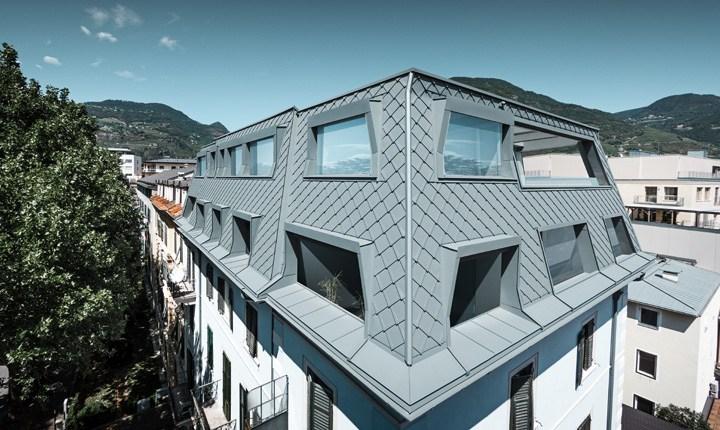 Prefa per la nuova copertura di un edificio storico a bolzano for Costo per costruire un edificio