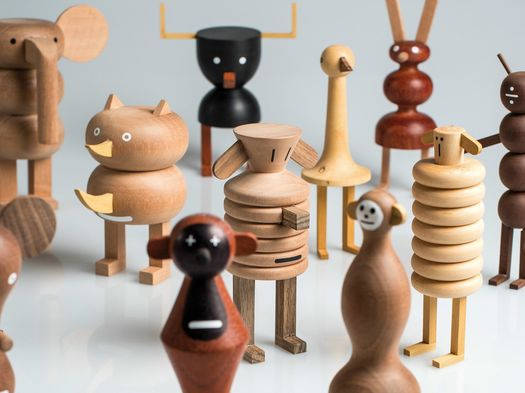 A cheerful crew of wooden creatures