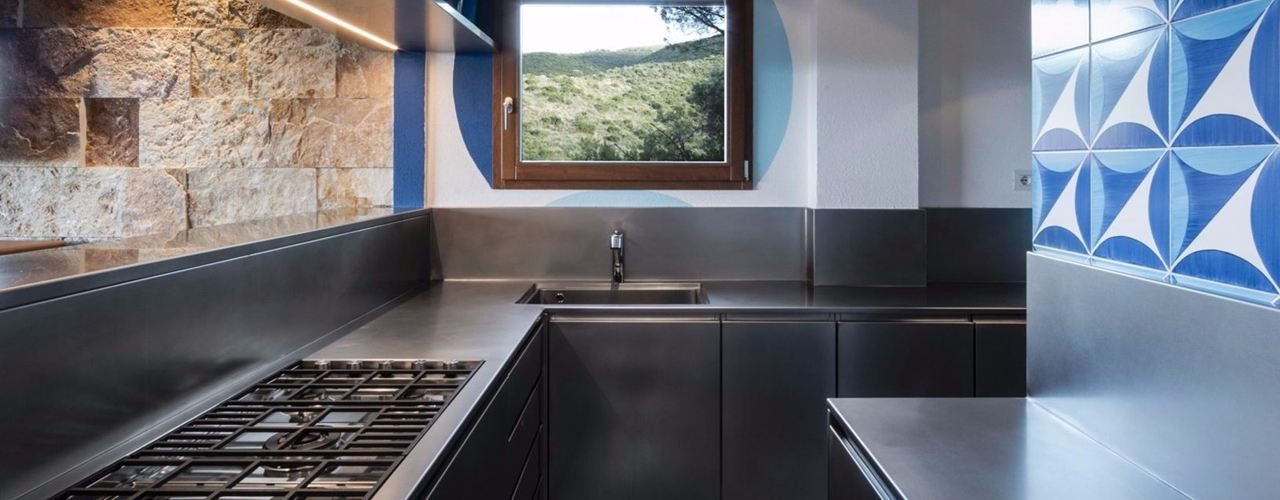 The stainless steel of the Abimis kitchen looking out to sea