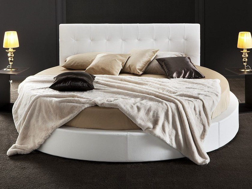 Round leather double bed with tufted headboard ARISTON by Chaarme