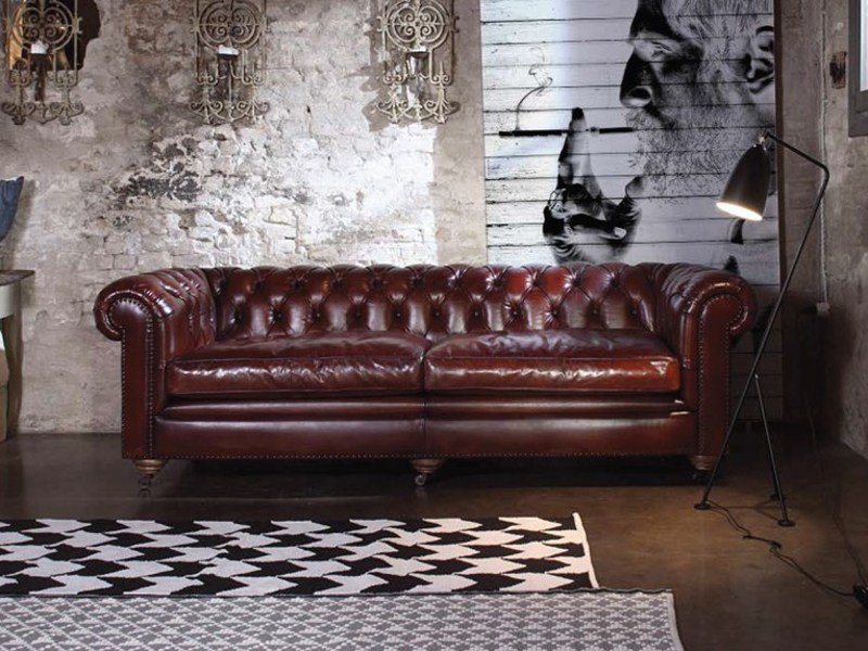 Tufted leather sofa with casters BRITISH | Leather sofa by Devina Nais