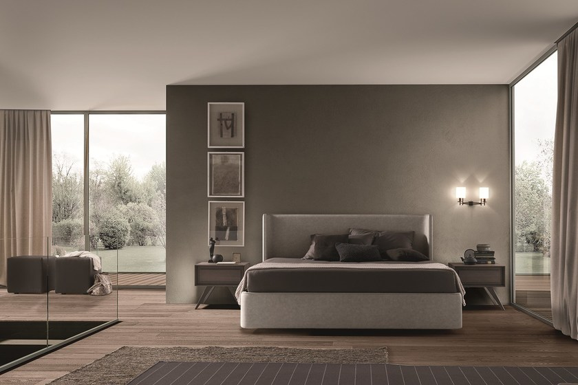 "Single-coloured Callas bed with frame upholstered in econabuk tecnopelle and Memories nightstands in ""aged"" tabacco oak."