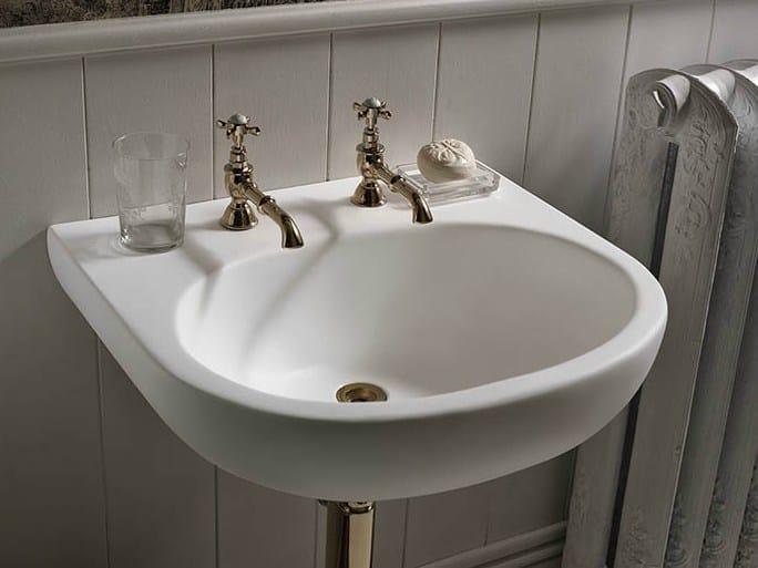 Single wall-mounted Corian® washbasin Corian® CALM - DuPont de Nemours Italiana - DuPont ProtectionSolutions