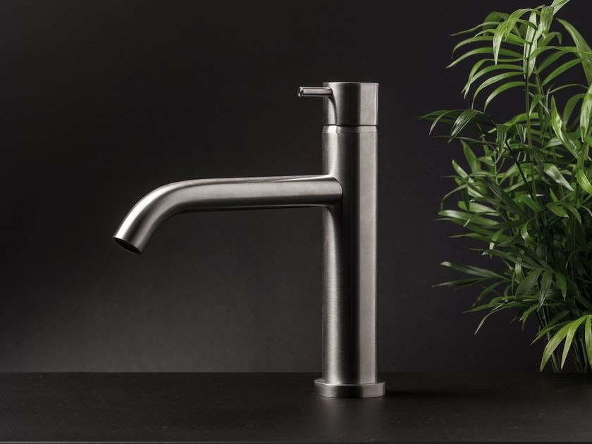 Single lever basin mixer curved spout