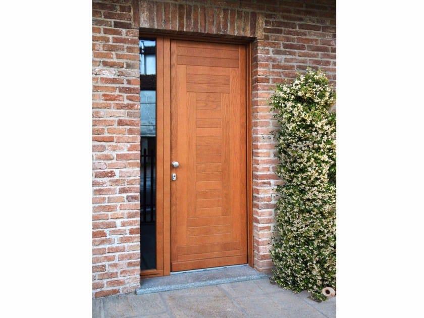 Porta d 39 ingresso in legno massello su misura portoni primo for Portoncino ingresso prezzi