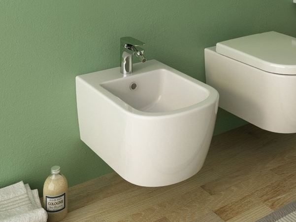 Wall-hung ceramic bidet with overflow FASTER | Wall-hung bidet - Hidra Ceramica
