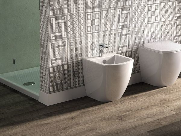 Back to wall Floor mounted ceramic bidet FASTER RIMLESS | Floor mounted bidet by Hidra Ceramica