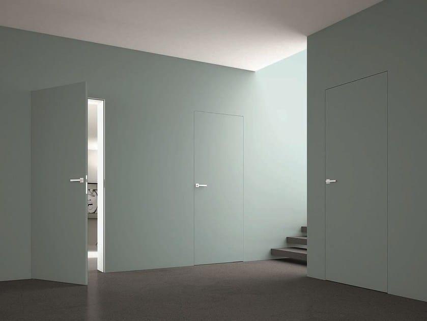 Porta a battente a filo muro filomuro zero porta a filo muro adielle - Porta a filo muro prezzi ...