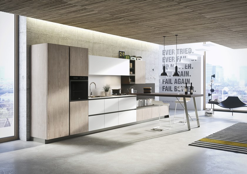 Contemporary style fitted kitchen with island with peninsula FIRST | Contemporary style kitchen by Snaidero