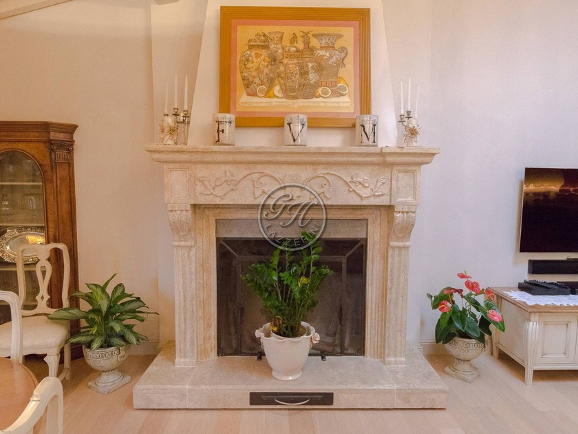Wall-mounted natural stone fireplace Fireplace 2 by GH LAZZERINI