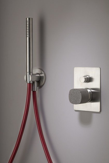 is HAPTIC brushed with handle made of concrete and red flexible