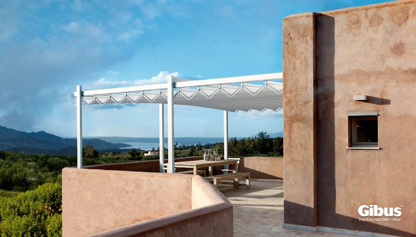 Wall-mounted motorized aluminium pergola with sliding cover MEDISOLAFLY FRONT LEANING - GIBUS