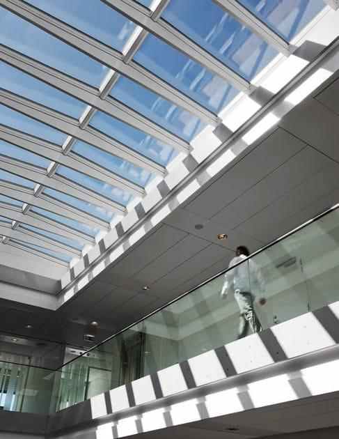 Finestra da tetto in acciaio e vetro modular skylights velux for Velux tetto