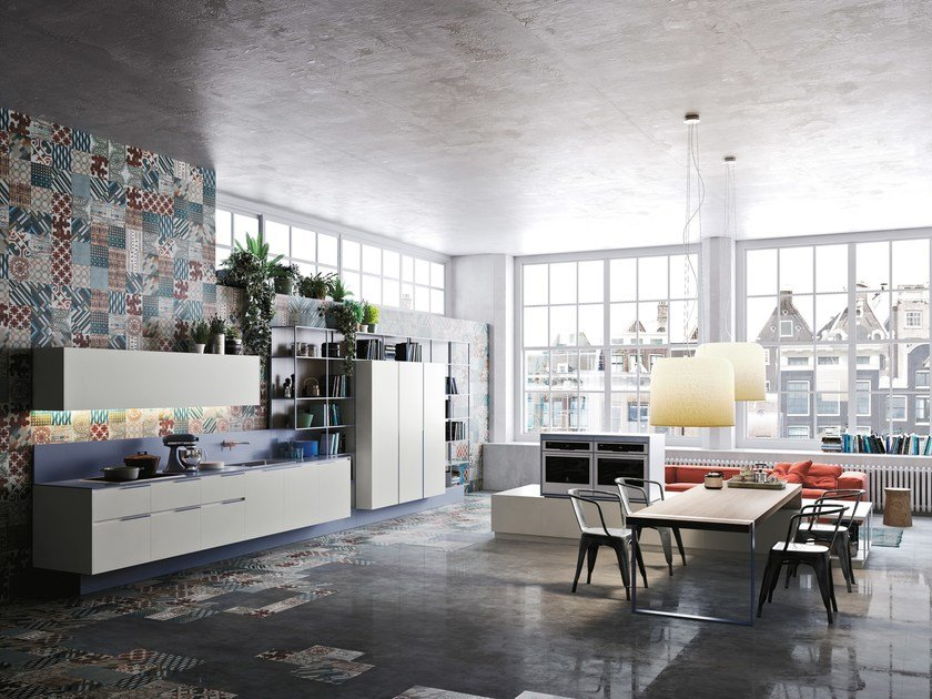 The space is defined by large monochromatic units adjacent to coloured elements following a customised palette of colours.