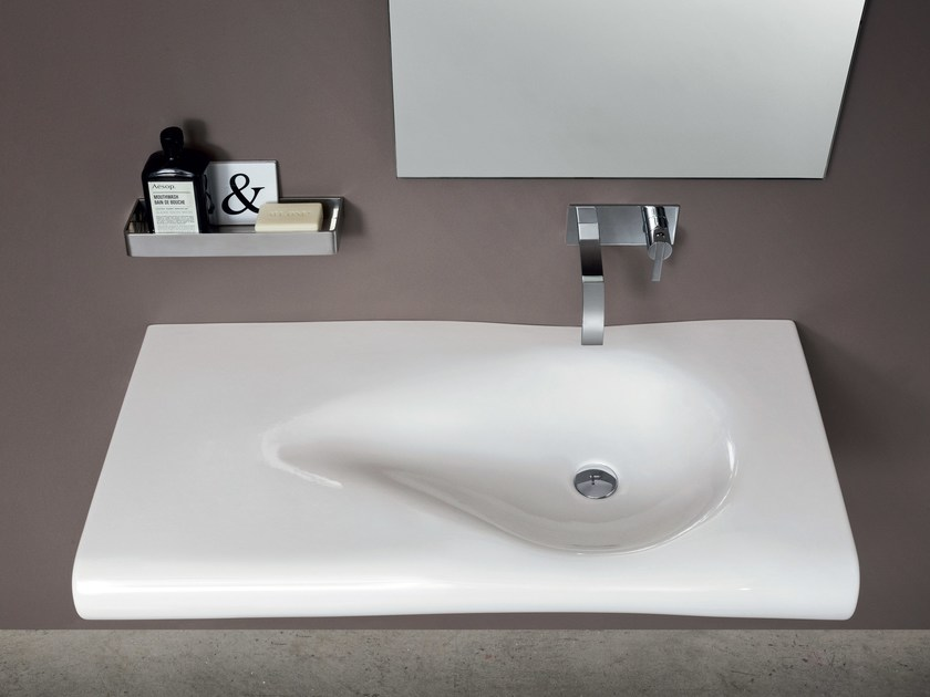 Wall-mounted ceramic washbasin PILLOW | Washbasin by Nic Design