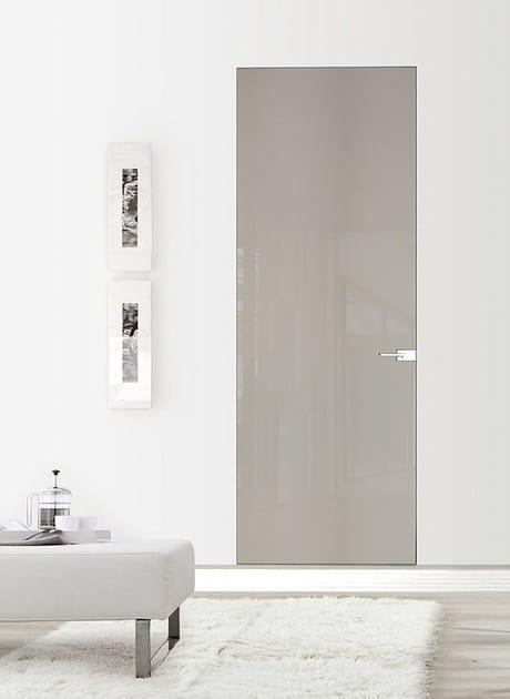 Porta a filo muro in vetro filomuro light porta a filo for Porta filo muro grezza