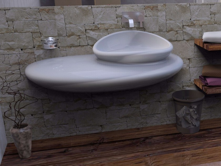 Wall-mounted Adamantx® washbasin with integrated countertop STONE - ZAD ITALY