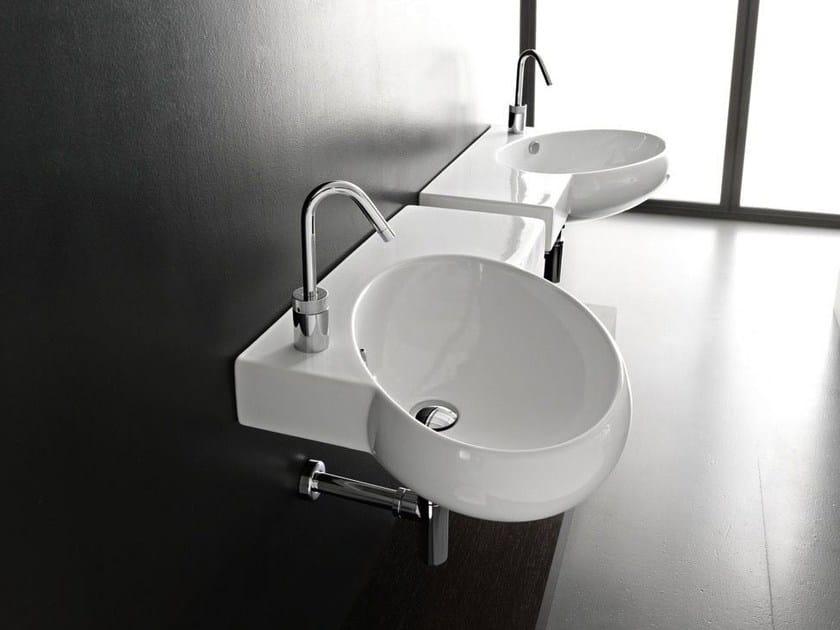 Wall-mounted washbasin TAO | Washbasin with integrated countertop - Hidra Ceramica