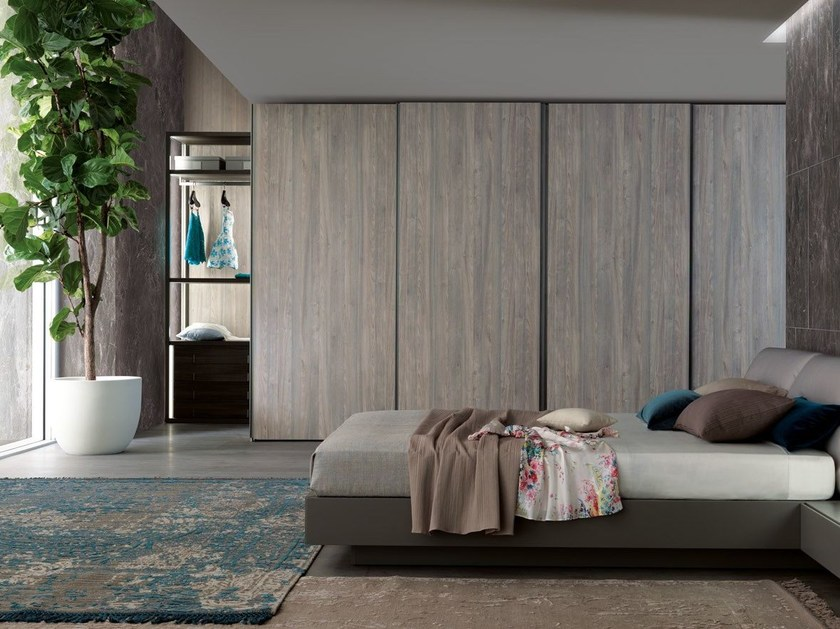 Sectional wardrobe with sliding doors TECNO WOOD | Wardrobe with sliding doors - MisuraEmme