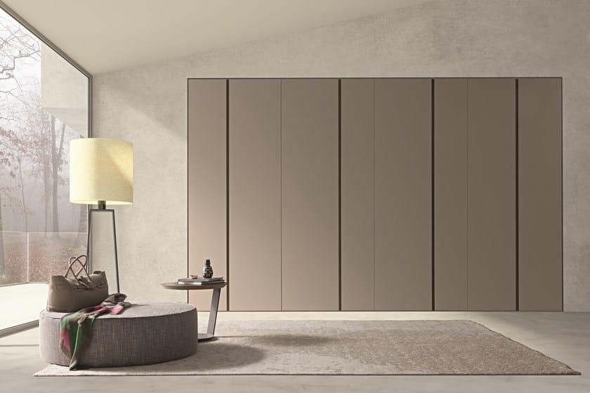 "Wardrobe with asymmetric Twin swing doors in matt beige cappuccino lacquer. ""Aged"" tabacco oak inset handles."