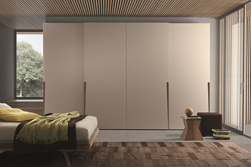 "Wardrobe with Jive sliding doors in matt beige cappuccino lacquer. ""Aged"" creola oak handles."