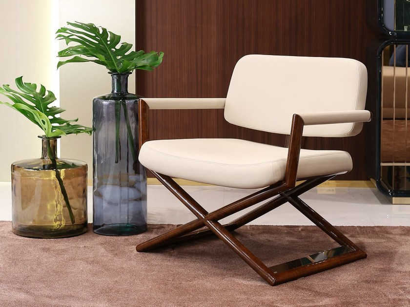 Upholstered leather easy chair with armrests MADISON | Easy chair by Turri
