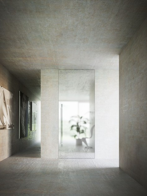 Porta a bilico a filo muro porta a bilico verticale - Finestre filo muro ...