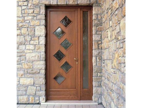 Porta d 39 ingresso in pino per esterno con pannelli in vetro - Porte ingresso vetro ...