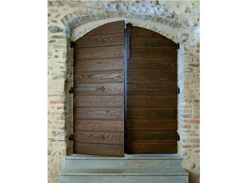 Arched exterior oak entry door Arched entry door - CARMINATI SERRAMENTI