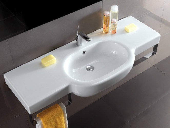Wall-mounted washbasin with integrated countertop with towel rail NICOLE | Washbasin with integrated countertop - Olympia Ceramica