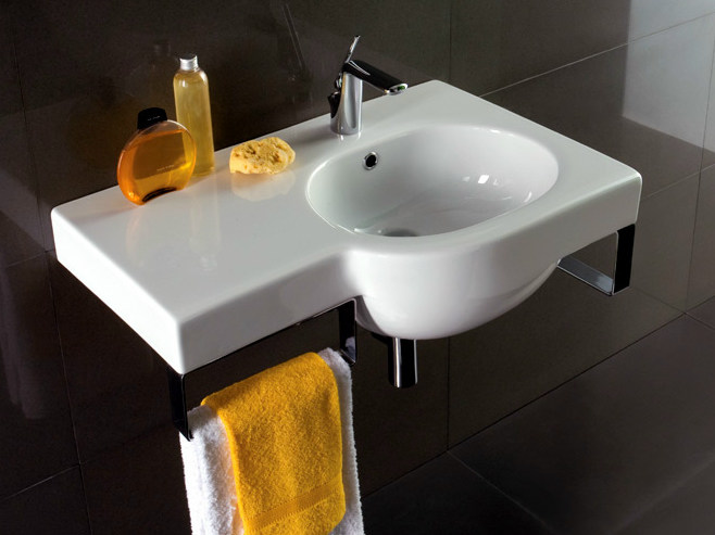Wall-mounted washbasin with integrated countertop with towel rail NICOLE | Washbasin with towel rail - Olympia Ceramica