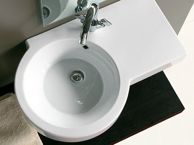 Wall-mounted washbasin with integrated countertop TUTTO EVO | Washbasin with integrated countertop - Olympia Ceramica