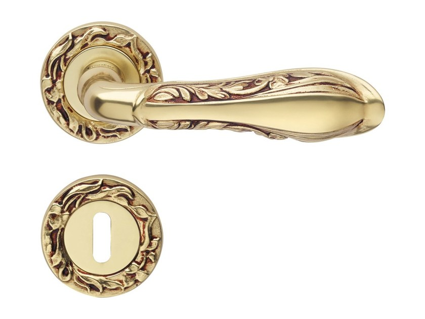 Chromed brass door handle on rose with lock LIBERTY | Door handle with lock - LINEA CALI'