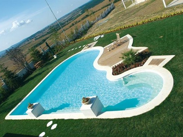 In-Ground reinforced concrete swimming pool DESJOYAUX | Free-shaped Swimming Pool - Desjoyaux Piscine Italia