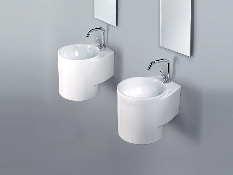 Wall-mounted handrinse basin round TUBE by A. e T. Italia