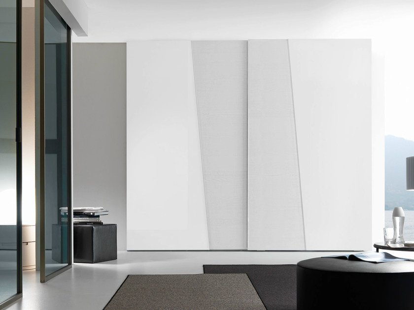 Wardrobe with gloss lacquered and bianco candido color wood Diagonal sliding doors and chromed concealed handles.