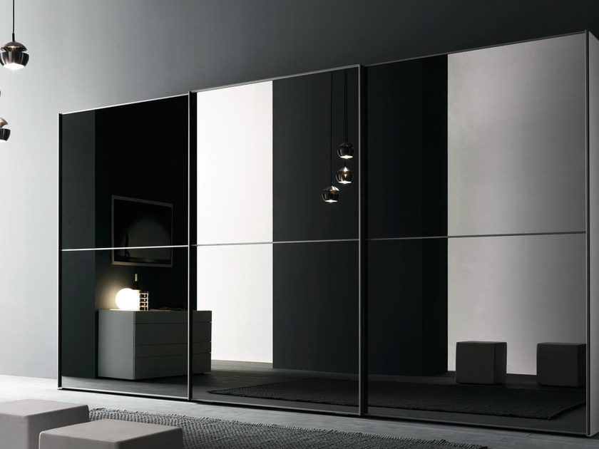 Wardrobe with L12 sliding doors with grey mirror panels and matt metallic grigio grafite lacquered frames.