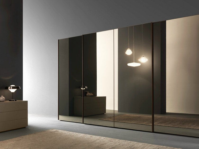 Wardrobe with Glass sliding doors, bronze mirror panels with matt marrone glace lacquered frames. Each sliding door is fitted with a standard dust guard.