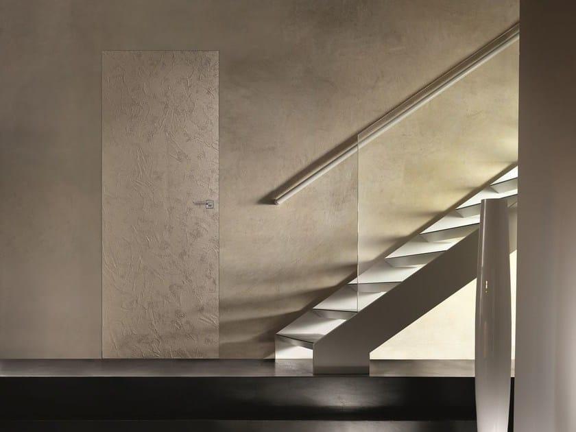 Porta a filo muro scorrevole con finitura effetto cemento - Porta scorrevole filo muro ...