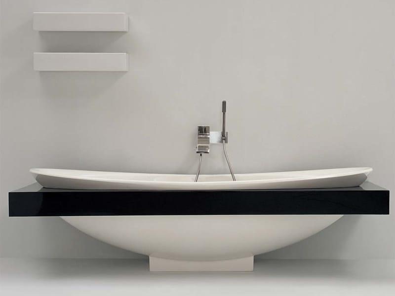 Vasca da bagno centro stanza in pietraluce io vasca da for Vasca centro stanza