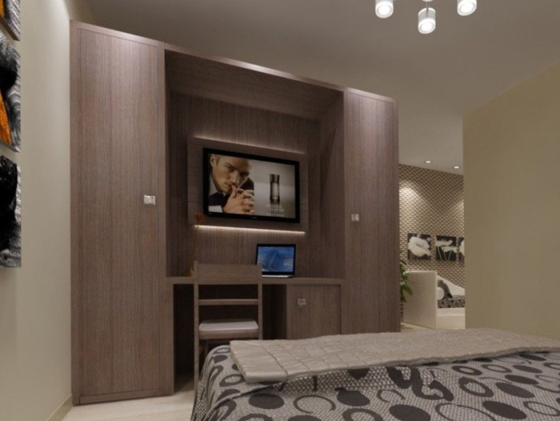 Melamine-faced chipboard wardrobe with built-in TV for hotel rooms ZEUS | Wardrobe with built-in TV - MOBILSPAZIO Contract