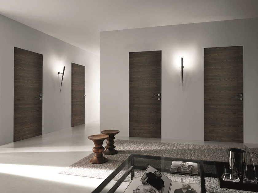 Porta a battente a filo muro in legno bisystem porta a for Garofoli listino prezzi pdf