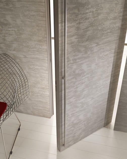 Porta a bilico a filo muro in cemento filomuro porta in for Porta filo muro grezza