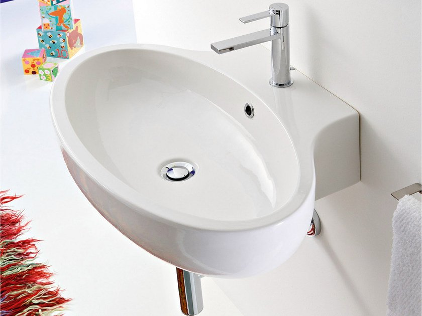 Oval wall-mounted ceramic washbasin PLANET | Oval washbasin by Scarabeo Ceramiche