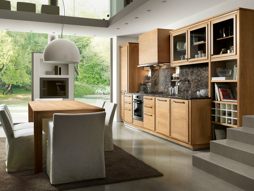 The EVITA kitchen in a linear composition, with differing depths which allow the backs to take on new functions.