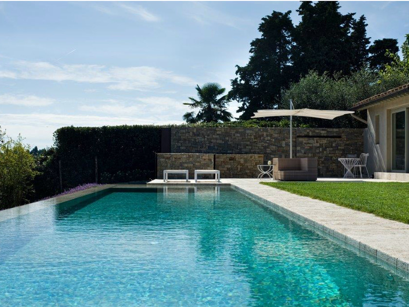 In-Ground travertine swimming pool Travertine swimming pool by INDALO PISCINE