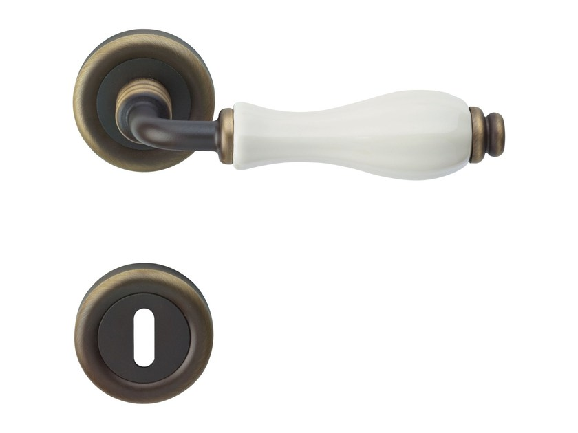 Classic style metal door handle on rose with lock ERICA | Door handle with lock by LINEA CALI'
