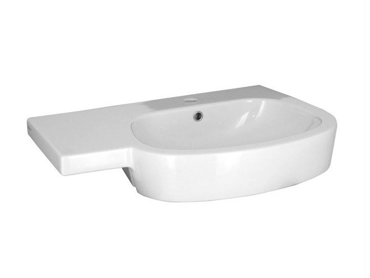 Oval washbasin with integrated countertop with overflow HOTELS | Washbasin with integrated countertop - NOKEN DESIGN