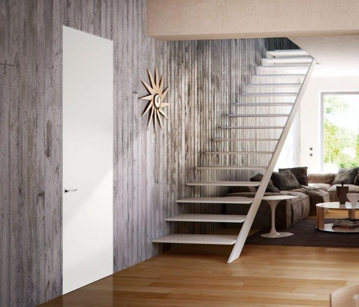 Porta a battente a filo muro in legno leggera porta a for Porta filo muro grezza