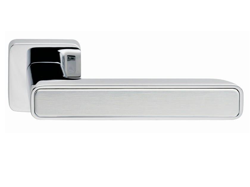 Zamak door handle on rose INNER METAL | Door handle by Frascio